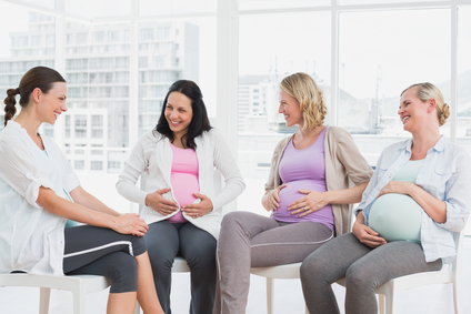 Happy pregnant women talking together at Renew Mama Circle in Grand Rapids