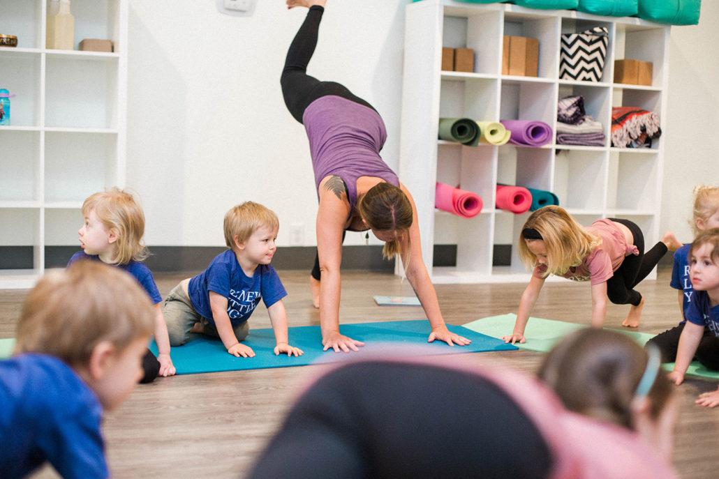 Teacher demonstrating in a toddler yoga class