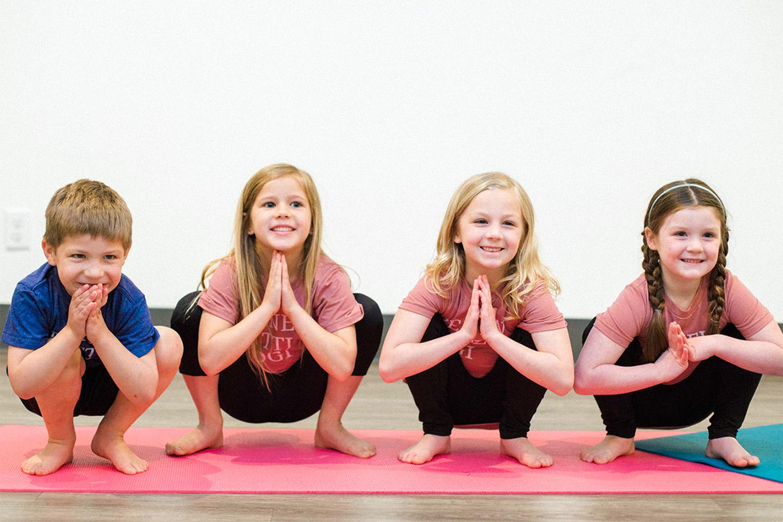 Kids practicing yoga Squat Pose