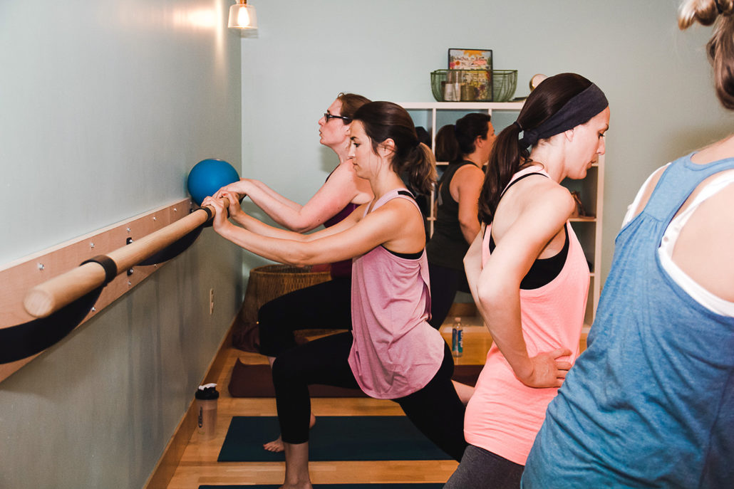 Five women in a barre class