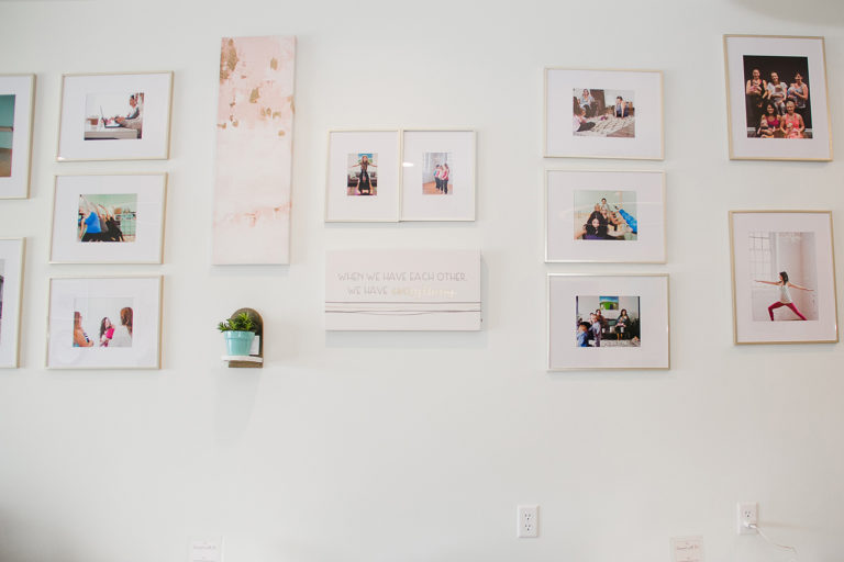 gallery wall of framed photographs