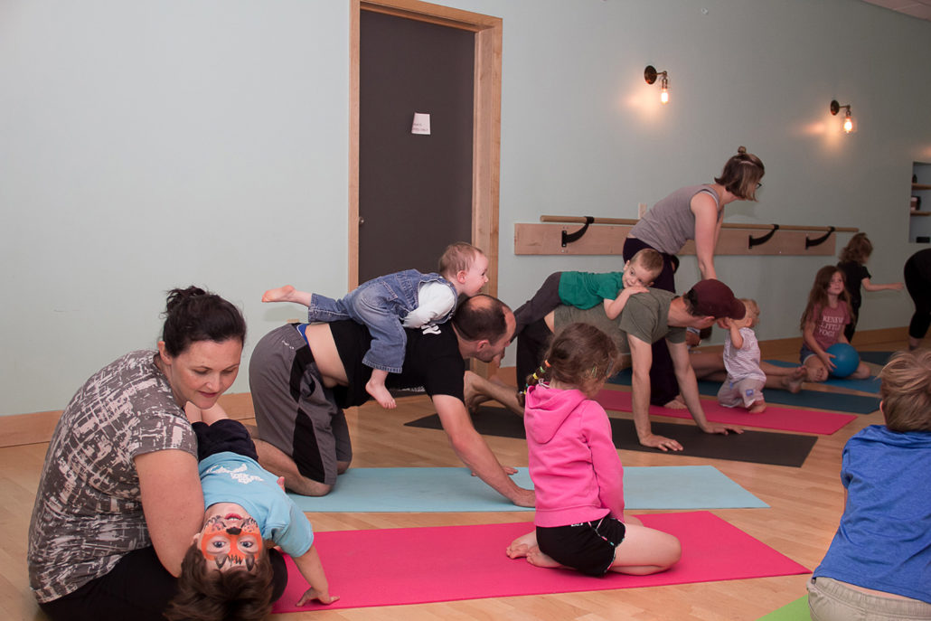 Mom and kids in a family yoga class