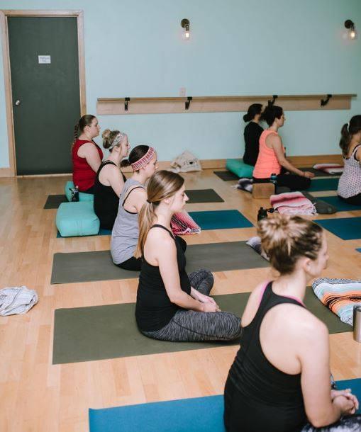 pregnant women in a prenatal yoga class