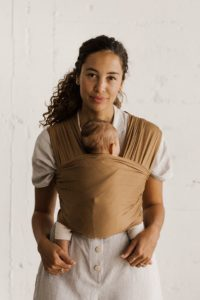 Woman using Solly Baby Wrap to wear her baby