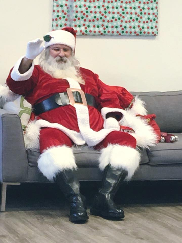 Santa sitting on a couch