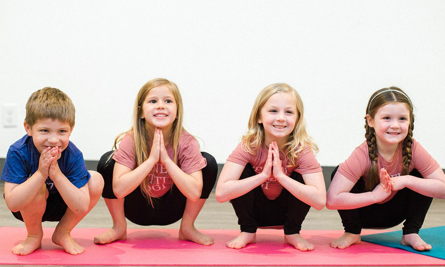 Kids practicing yoga Squat Pose
