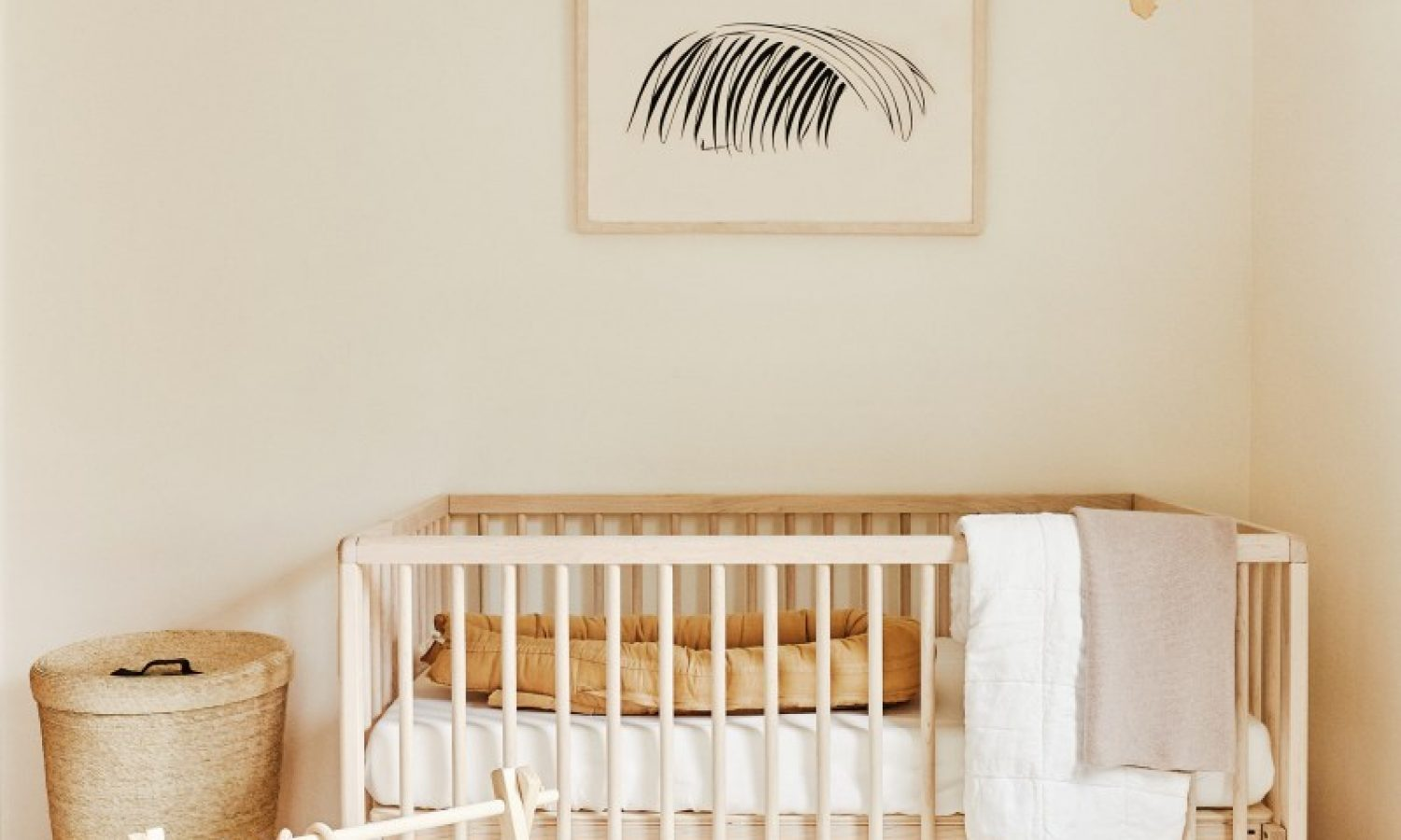 baby nursery with crib, mobile, and fuzzy rug